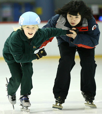 Having fun with coach at skate school